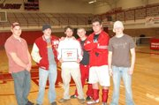 A.J. DeMaranville, left, Wyatt Coffin, Tonganoxie coach Jeremy Goebel, Travis Adcox, Cameron Adcox and Matt Ditty gather around the winning plaque at the Ross Starcher Invitational on Saturday. It was the first time the Chieftains won the invitational against a complete field.