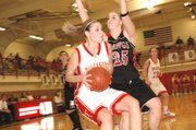 Tonganoxie senior forward Shannon Carlin makes a move to the basket in the first round of the Tonganoxie Invitational on Tuesday. THS defeated Rossville, 50-43.