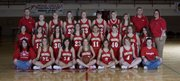 The Tonganoxie High girls basketball team is, front row, from left, manager Amanda Albert, Shannon Carlin, Liz Baska, Christy Weller, Cara Carlisle, Tracie Hileman and manager Ali George; middle row, manager Rachel Orrison, Madi Yates, Abby Eisman, Chrissie Jeannin, Ronnie Grizzle, Danielle Miller, Lindsey Fatherley and manager Larissa Mansor; back row, assistant coach Jared Jackson, Lauren Hall, Nicole Pennington, Jessica Stinson, Hilary Saathoff, Marie Faisant, Courtney Theno, Andie Jeannin, coach Randy Kraft and assistant coach Lindsey Graf. The Tonganoxie girls enter the Tonganoxie Invitational the top-ranked team at 8-2. In the four years of the girls bracket existing in the Tonganoxie Invitational, the THS girls have reached the finals each year. The Chieftains have won the tournament twice.