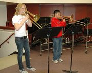 Edwin Fluevog, 18, left, and Stephen Long, 16, both trombone players at Lansing High School, won spots on The Kansas Music Educators Association All-Sate Band making them two of the top 100 high school musicians in the state. The two will soon travel to Wichita were the entire state band will practice for three days as an ensemble before giving a final performance.