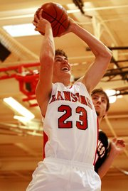 Lansing High senior Bobby Hauver muscles his way to the basket during Lansing's 48-46 victory over Jeff West.