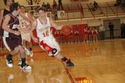 Tonganoxie freshman guard Jeremy Carlisle drives the lane in the fourth quarter of Thursday's Tonganoxie Invitational consolation semifinals against Silver Lake. THS lost, 49-42.