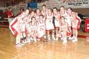 The Tonganoxie High girls basketball team celebrates its victory aganinst Eudora in Saturday's Tonganoxie Invitational finals. The victory marked the third time in five years the Chieftains have won their home tournament.