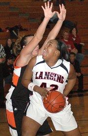 Lansing High junior Alexis Ellis muscles her way to the basket against Bonner Springs' Felisha Leipard during Lansing's 52-43 victory Friday night.