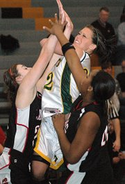 Basehor-Linwood's Bren Koontz crashes into the Lansing defense on her way to the basket.