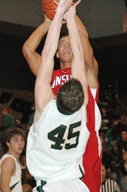 Lansing High senior Stephen Didde puts up a shot over Basehor-Linwood's Scott Ogilvie.