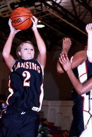 Lansing High senior Amanda Darrow goes up for a shot during Lansing's 60-49 victory over Piper.