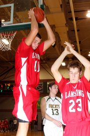 Lansing High junior Cody Rush hauls down a rebound during Lansing's 63-53 loss at Basehor-Linwood.