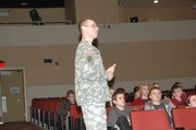 Army Maj. Stan Wiechnik presents a slideshow to THS students Friday regarding America's involvement in Iraq and Afghanistan. The six Army majors who presented in the Tonganoxie Performing Arts Center said it would be dangerous for the next president to suddenly pull out U.S. forces from Iraq.