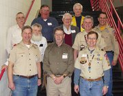 Former Cubmasters of Pack 3165 gather with over 300 other people Saturday, Feb. 23, to celebrate the 50th anniversary of the founding of scouting in Lansing back in 1958. The former Cubmasters in attendance were: (front row left to right) Howard (Howie) Kings; Andy Matzeder, the first Cubmaster; Karl Gibson; (second row left to right) Dan Golden; Dean Moburg; (third row left to right) Paul Icke; Dan Mosier; Doug Lilly; (fourth row left to right) Ron Bishop; and Loren Russell.