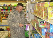 Maj. Scott Holland, Lansing, shops at Fort Leavenworth's Commissary Wednesday, March 5. Holland said he's seen price increases for basic items like meat and milk, but he also said prices, in general, are significantly less than at grocery stores off-post.