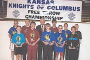 Sam Lorenzen, at far right in front row, won the Knights of Columbus State Free Throw Championship on Sunday, March 2, in Salina at the Sacred Heart High School gymnasium. Lorenzen made 21 out of 25 free throw attempts, two more than his closest competitor, in winning the 10-year-old boys age division. Lorenzen is pictured with the winners from all age divisions, as well as State Deputy Donald Wagner. By winning his age division, Lorenzen's score was sent to the Knights of Columbus Supreme Council, where he could be selected to compete in the international contest.