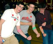 Last April, Tonganoxie High School Student Council members Tyler Miles, Mike Fonkert and John Davis show off their blood donation bandages and stickers during a community blood drive on the THS west campus. StuCo sponsor Jessica Johnston said the drive, led by the Community Blood Center in Kansas City, Mo., was the school's largest with 106 units, or pints, of blood donated. The Student Council provided door prizes including video gaming unit, a digital camera and gift certificates to Target and Best Buy, to a few lucky donors,.