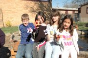 "Third-grade students at Tonganoxie Elementary School show off Tootsie Pop ""flowers"" they made for a fundraiser that will help purchase flowers and other items for the TES outdoor classroom. From left are Luke Falk, Braden Shyrock, Lucy  Collings, Destiny Thompson and Anah Puevla."