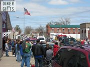 A crowd gathered along Union Street in downtown McLouth Saturday afternoon to watch the city's 10th annual Patriots' Day Parade. The parade, which featured various civic organizations, military personnel and historical re-enactors was held to remember the American Revolutionary War as well as to honor and remember those who are serving and have served in the United States Armed Forces.