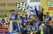 Ron Hornaday Jr., left, celebrates with his pit crew after their NASCAR Craftsman Truck Series victory. Hornaday won Saturday at Kansas Speedway.