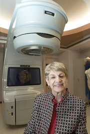 Rep. Marti Crow, D-Leavenworth, went through a series of radiation treatment under the machine behind her at the Peet Center at St. Luke's Hospital. Crow started radiation after undergoing chemotherapy and a mastectomy.