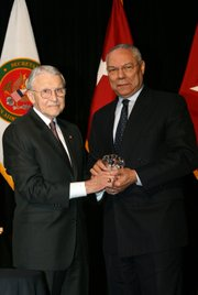 Retired Army Lt. Gen. Robert Arter, chairman of the Command and General Staff College Foundation, presents Colin L. Powell with the CGSC Foundation Distinguished Leadership Award at a dinner banquet in Kansas City, April 29.  Powell, former Secretary of State and Chairman of the Joint Chiefs of Staff, was in Kansas City as part of a two-day trip to deliver the inaugural lecture for the Colin L. Powell Lecture Series at the U.S. Army Command and General Staff College, at Fort Leavenworth.