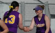 McLouth Bulldogs Lezley Lawson and Sam Farris go through their between-innings routine during a doubleheader against Silver Lake on Thursday at McLouth High.