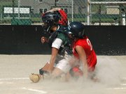 Tonganoxie's Lauren Himpel slides safely past Basehor-Linwood catcher Codi Schierbaum.