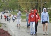 Tonganoxie High School students walked around town in the rain to get from one job to the next.