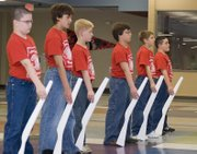 Members of the Tonganoxie Middle School Warrior Guard line up in formation during the armed drill section of Saturday's competition .