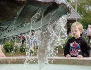 Lucas Hopper, 5, watches the Baker University Fountain Wednesday evening. Hopper was downtown with his mother Sarah Hopper.
