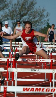 Tracie Hileman qualified for state in four events, including her second-place finish in the 100-meter hurdles. She won the triple jump, finished second in the long jump and took third in the high jump.