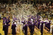 The graduating class of Baldwin High School celebrates the end of Saturday's ceremony with the annual tradition of spraying silly string.