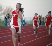 Christy Weller heads for the finish line in the girls 800-meter, which she won for Tonganoxie.
