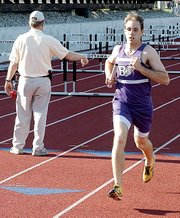 Baldwin High School senior Aaron Karlin competes in the 3,200-meter relay Friday at the regional meet. Baldwin placed third in the event, but sits fifth in the state with its regional time of 8:29.22.