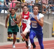 D.J. Lindsay glances at the opposition during the final stretch of his 200-meter run on Friday at Cessna Stadium. Lindsay's time of 23:19 qualified him for Saturday's finals.