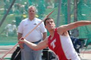Gabe Belobrajdic looks upward while throwing the javelin on Friday. The THS senior finished seventh in the state with a throw of 167 feet, 6 inches.
