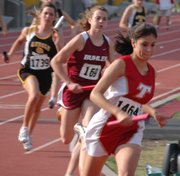 Christina Rubio makes the first turn on her leg of the 4x400 relay for Tonganoxie.