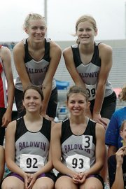 Baldwin High School won the Class 4A girls' 3,200-meter run Saturday morning at the state meet. BHS set the school record by running 9:41.09. The team members are shown here on the awards' stand. Front row, from left, are junior Calleigh Durr and senior Heather Garcia. Back row are junior Corinna Papps and sophomore Connor Twombly.