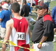 Dave St. Cyr talks with Gabe Belobrajdic before the senior throws at state.