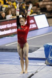 Kaylan Clevinger didn't hide her excitement after sticking a landing at the NCAA Championships. The Shawnee resident and Ohio State senior gymnast earned All-American honors in the uneven parallel bars.