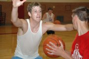 Rising senior Austin Smith closes out on Tommy Heskett during one of many defensive drills at the camp.
