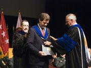 U.S. Sen. Sam Brownback was given an honorary degree during the Command and General Staff College graduation ceremony Friday at Fort Leavenworth. Brownback replaced U.S. Rep. Steve Israel as the commencement speaker after Israel couldn&#39;t make it to the Fort because of the weather. 