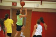 Chrissie Jeannin drives in for a layup during Tonganoxie High girls basketball camp last week.