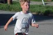Gad Huseman, 8, finished the 5K race 26th overall with a time of 27:23.