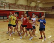 Members of the Tonganoxie High girls basketball team jockey for rebounding position at the beginning of a camp fastbreak drill.