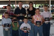 Top finishers at the Leavenworth County Swine Show are, back row from left, Thatcher Moddie, Burlington, Champion Intermediate Showman; Blaine McDougal, Leavenworth, Champion Senior Showman; Kylie Stinson, Allen, Reserve Senior Showman; Dakota Ferguson, Williamsburg, Reserve Intermediate.  Front row from left, Paxton Dahmer, Nevada, Mo., Champion Junior Showman; Kody Hendrickson, Paola, Champion Pee Wee; Zane McDougal, Leavenworth, Reserve Champion Pee Wee; and Megan Davis, Princeton, Reserve Champion Junior Showman.