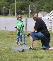 Jacob Reynolds helped the members of this year's 4-H Club tech camp launch rockets the 4-H'ers designed and constructed themselves. The camp also taught the Leavenworth County youths about robotics and geoscapings.