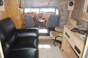 The inside of Tenpenny's semi shows off plenty of comfort with plush seats and a big screen TV.