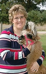 Jennifer Goff of rural Baldwin City poses with one of the llamas from the Dream Factory.