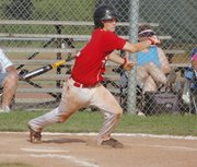 Tonganoxie's Brett Bailes follows through on his swing during Post 41's 17-4 loss to the Easton Outlaws.
