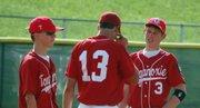 Post 41 infielders Brett Bailes, Ryan Stockman and Jon Harris talk during a pitching change on Sunday.