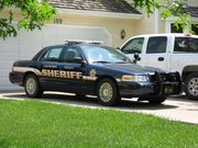 A Leavenworth County sheriff's office squad car sits at a residential address in Leavenworth County. Sheriff Dave Zoellner said he's looking at ways to conserve gasoline in his department to combat rising gas prices.