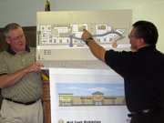 In this 2006 file photo, Basehor Mayor Chris Garcia points to a map of the Wolf Creek Junction development, which is to be the home of Wolf Creek Market grocery store.